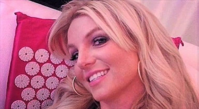 Britney Spears sexy selfie in her bed looking into the camera and smiling