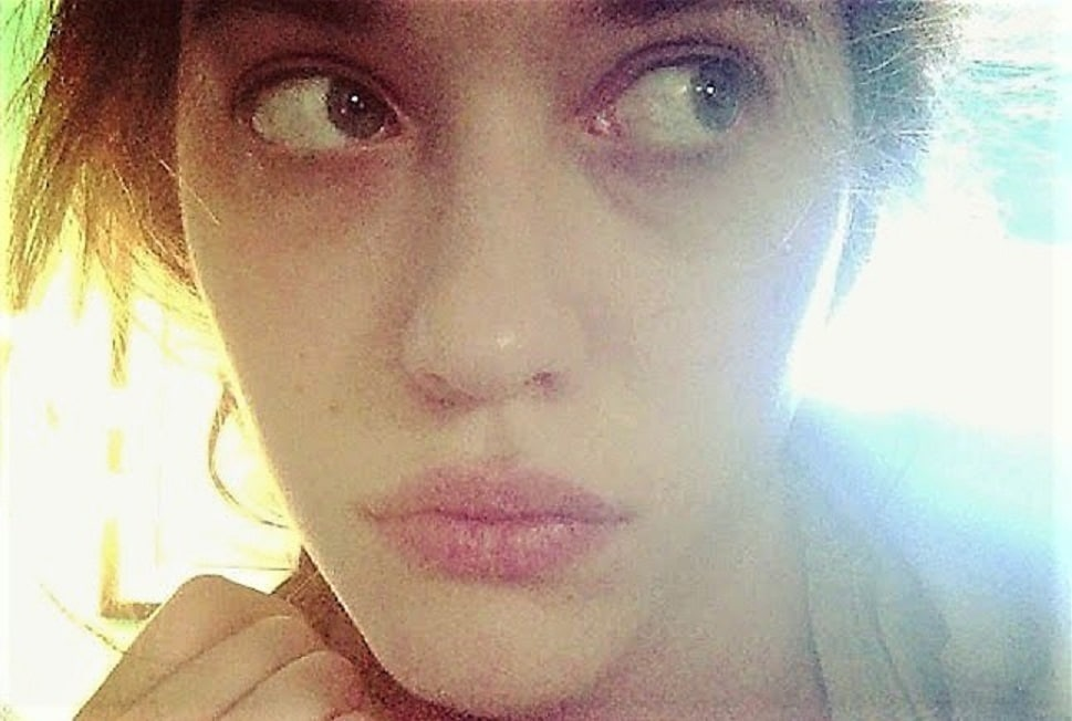 icloud leaked pic of kat dennings looking to the right and pouting her lips