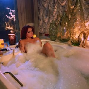 Naked Ariel Winter covered in suds