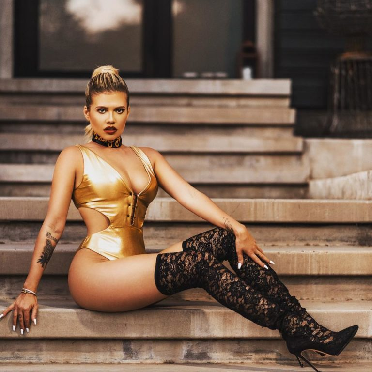 reality star and rapper chanel west coast in golden body suit showing off her legs in high thighs
