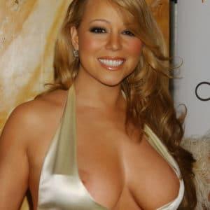 diva mariah carey suffers a nip slip in gold dress at awards show