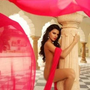 totally naked poonam pandey with her legs wrapped around a column