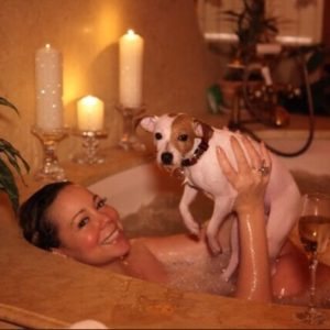 hot pic of mariah carey in her bathtub naked holding up her puppy