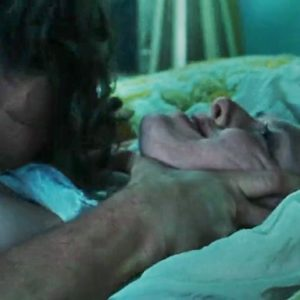 amanda seyfried being choked in bed with her breasts showing