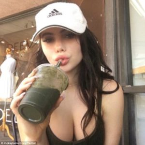 McKayla Maroney showing her cleavage wearing a white hat