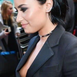 Demi Lovato at event suffers a nip slip