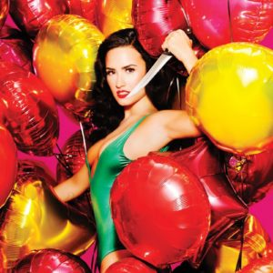 Demi Lovato in a green one piece with lots of balloons for Complex