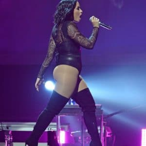 Demi Lovato singing in concert with high thighs on and showing off her
