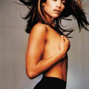 J Lo grabbing her breasts in modeling pic with hair flowing