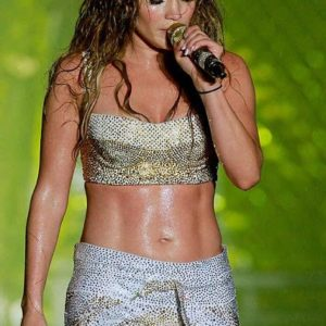 Jennifer Lopez performing in concert with a sports bra on revealing her core