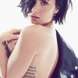 Topless photo of Demi Lovato showing her side tattoo